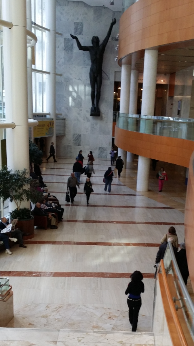 photo taken at Mayo Clinic Gonda Building with woman wearing a fashionable black outfit with a silver concho belt