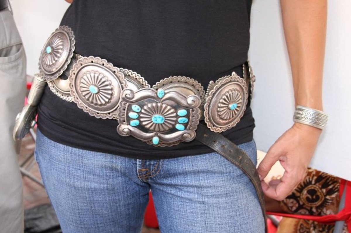 #3 large concho belt with turquoise over a black shirt and blue jeans