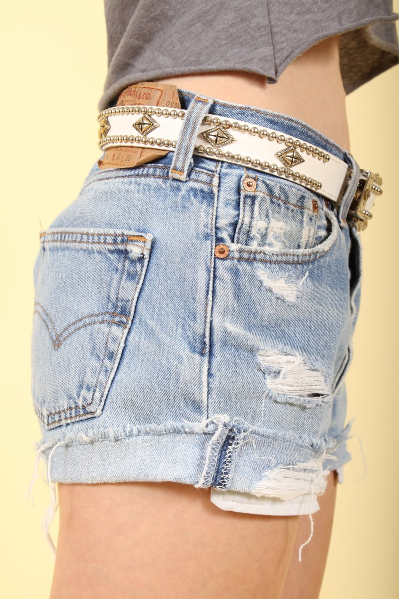 #6 white concho belt with faded blue jean shorts
