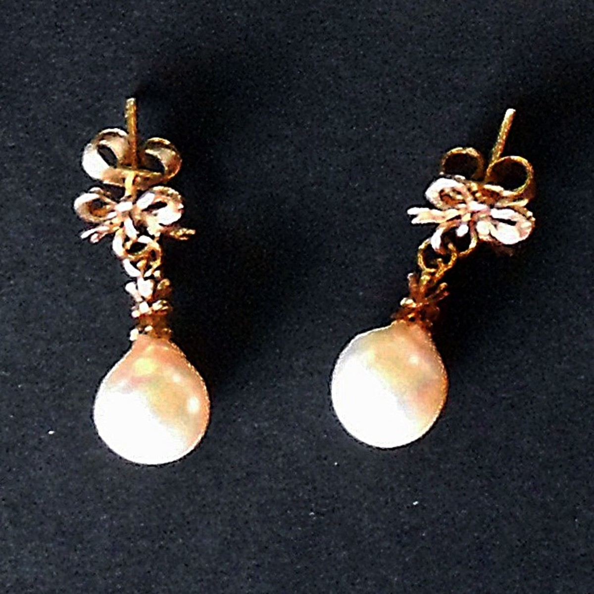 Pearls need careful care and should be wiped with a damp cloth after wearing.
