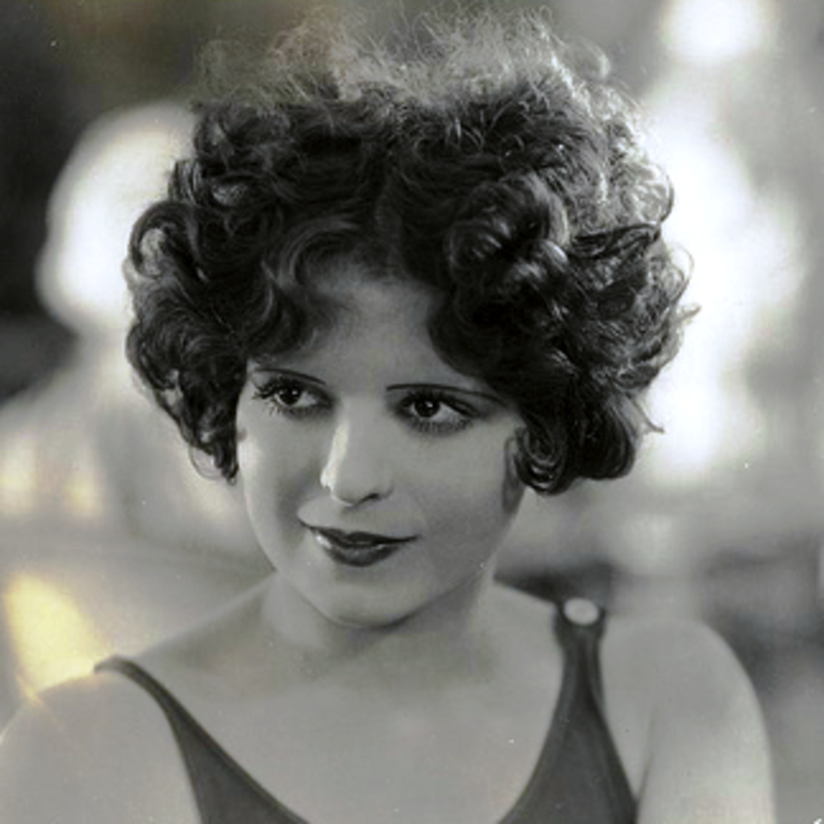 Clara Bow with a short, curly bob.
