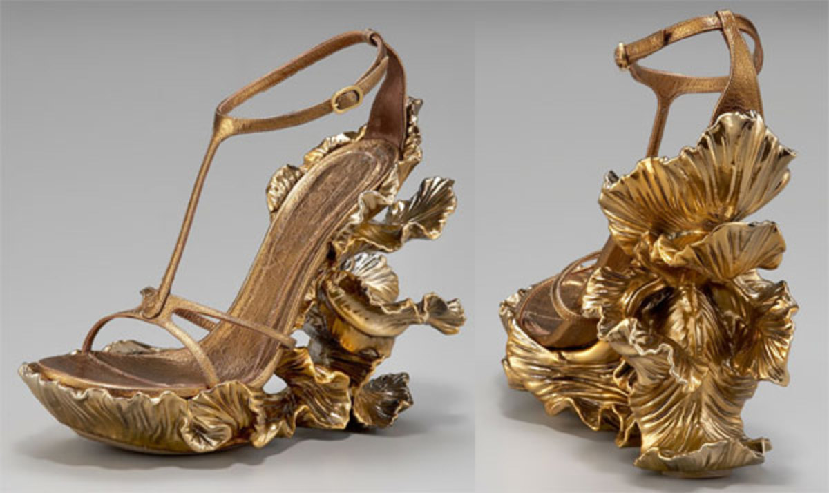 Don't forget to take your wallet for the spare $65,000 of antiques you will need to purchase when she wears these to auctions. You've shown your generosity by giving her these shoes, now stump up for the real event!