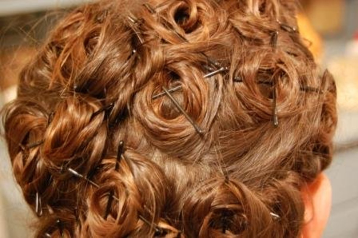 Hair should look like this in the end. Criss-crossing bobby pins over curls ensures a secure hold.