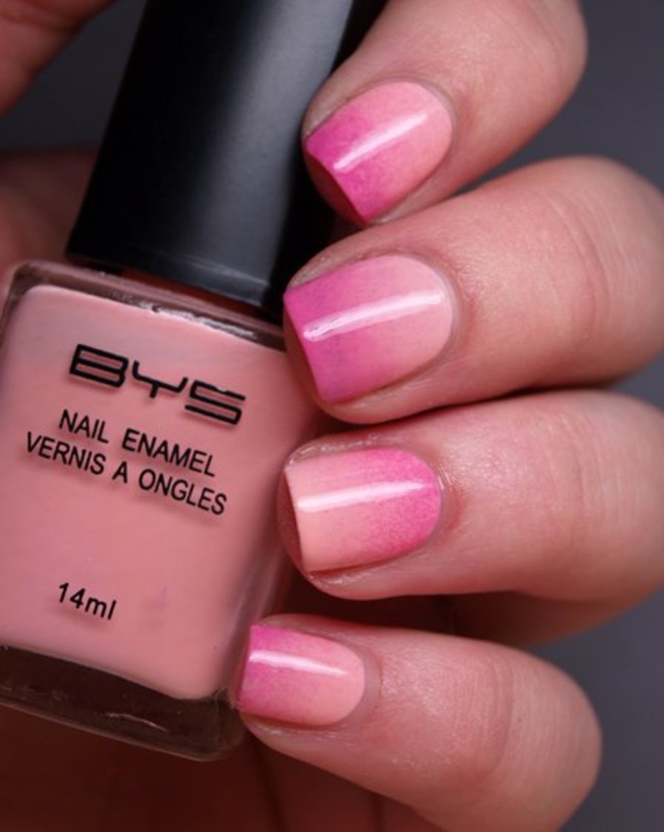 Ombre pink nails.