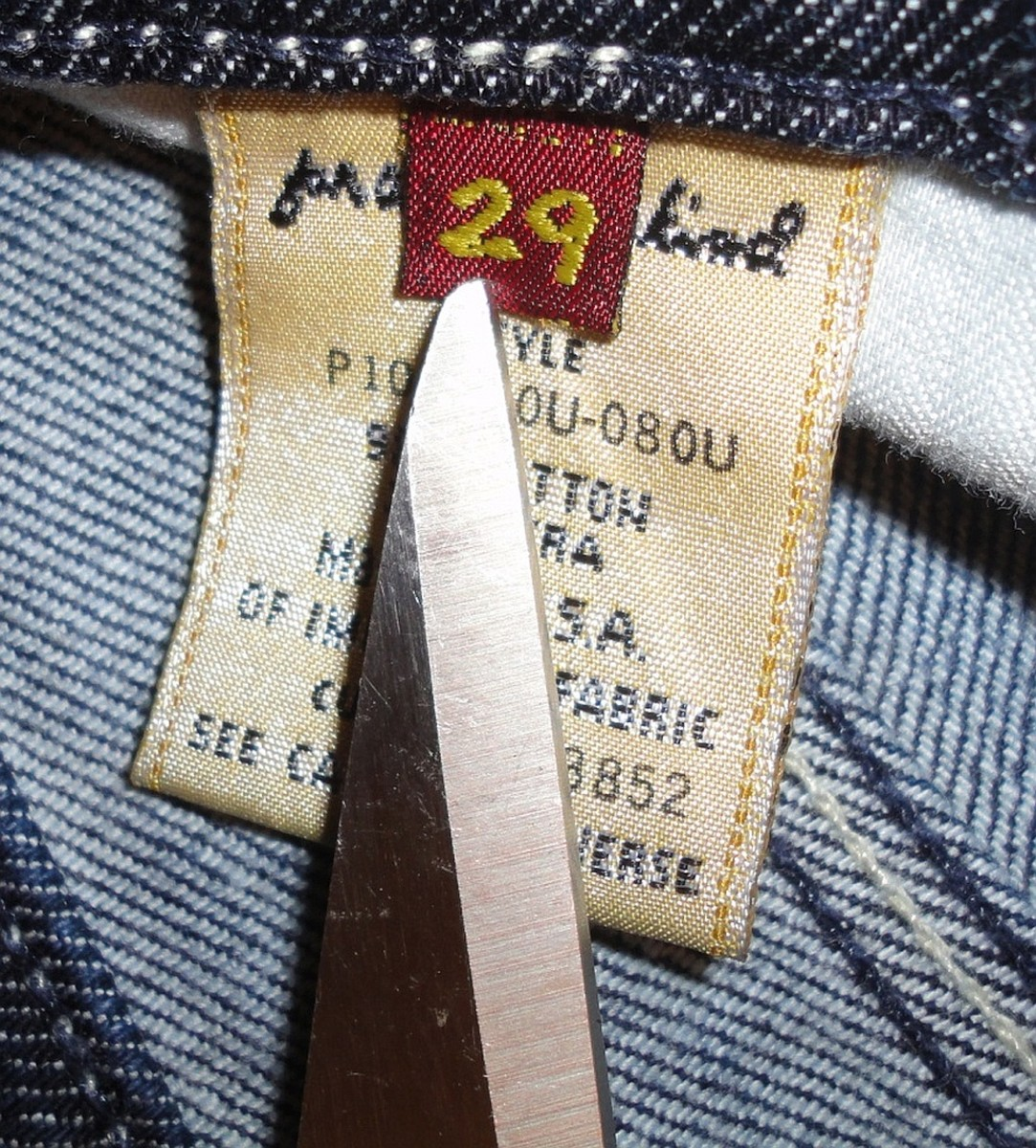Genuine brand label showing detailed stitching & font on the inside tag