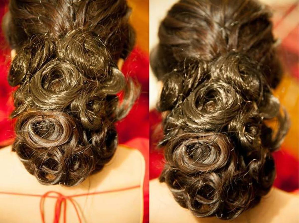 Gorgeous low hanging hair updo with a heavy hair bun resting at the nape of the neck.