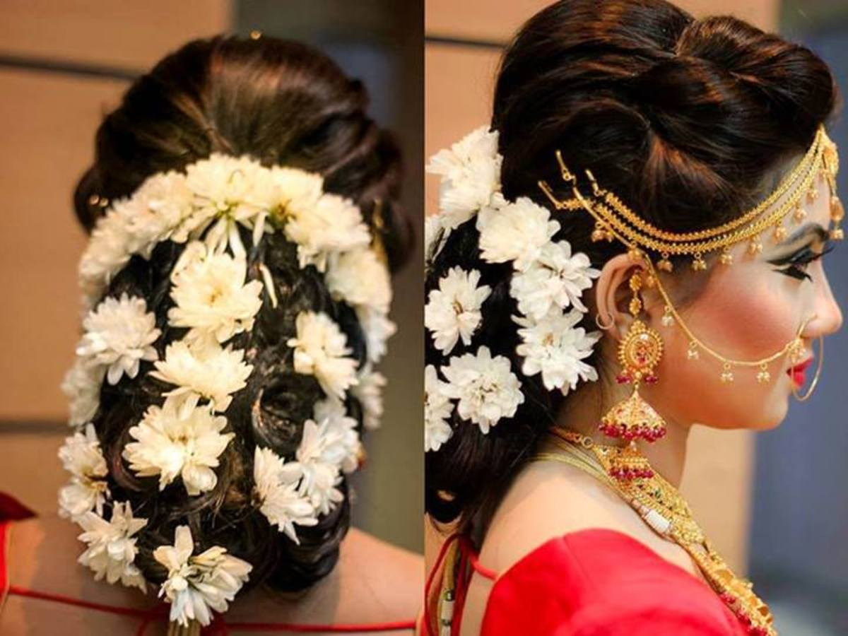 Beautiful low bun with white flowers with a gorgeous front setting.