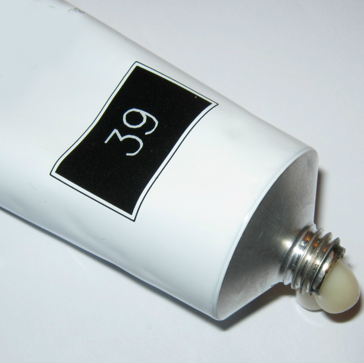 You might find the developer in a large applicator bottle, but the color itself is always in a tube and labeled with its shade number.