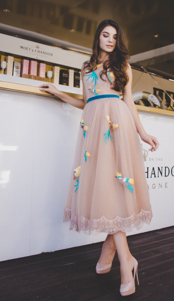 Gorgeous peach organza dress perfect for a wedding.