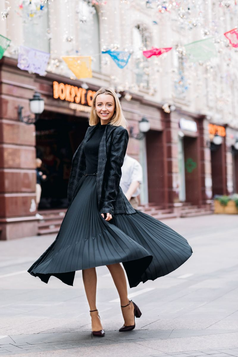 A midi-skirt and top can be paired with a blazer for a winter wedding.