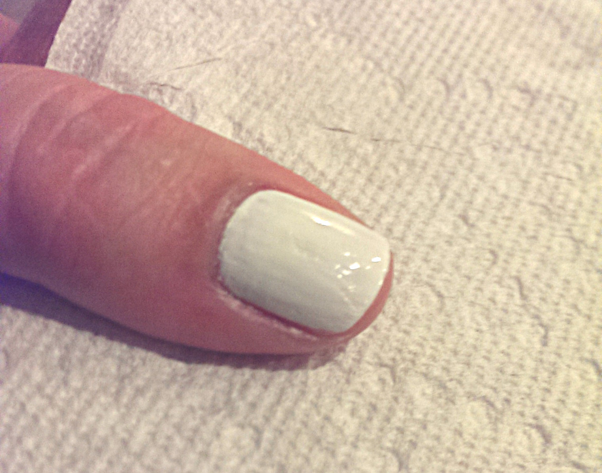 Paint the base coat as smoothly as possible. Use Q-Tips and nailpolish remover to touch up around the cuticles. Make sure to let this dry COMPLETELY before doing the next step!