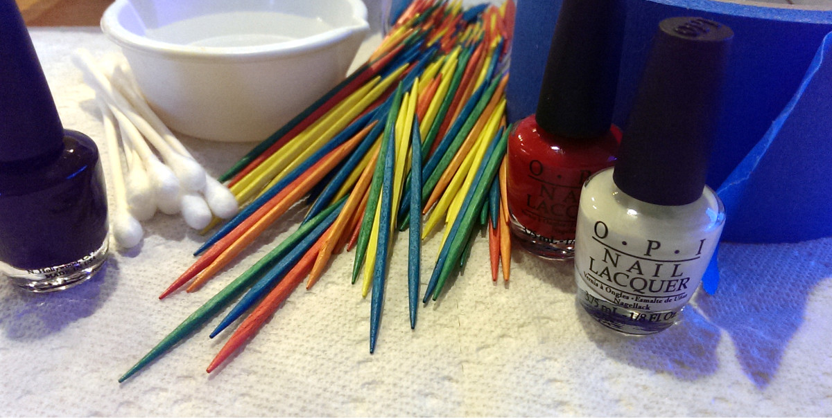 Supplies needed to create marbled nails at home.