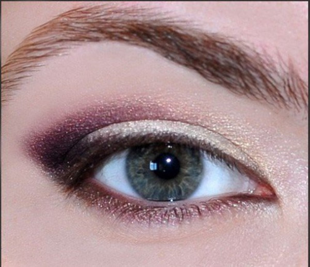 Use a sparkly white eye shadow to brighten inner corners & arch of brow bone.