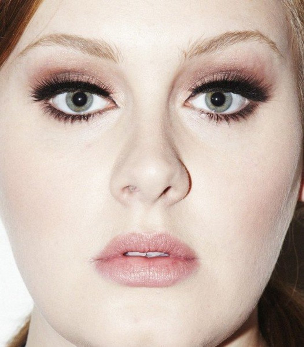 Dark shadow will help make large eyes look smaller, as it does for Adele.