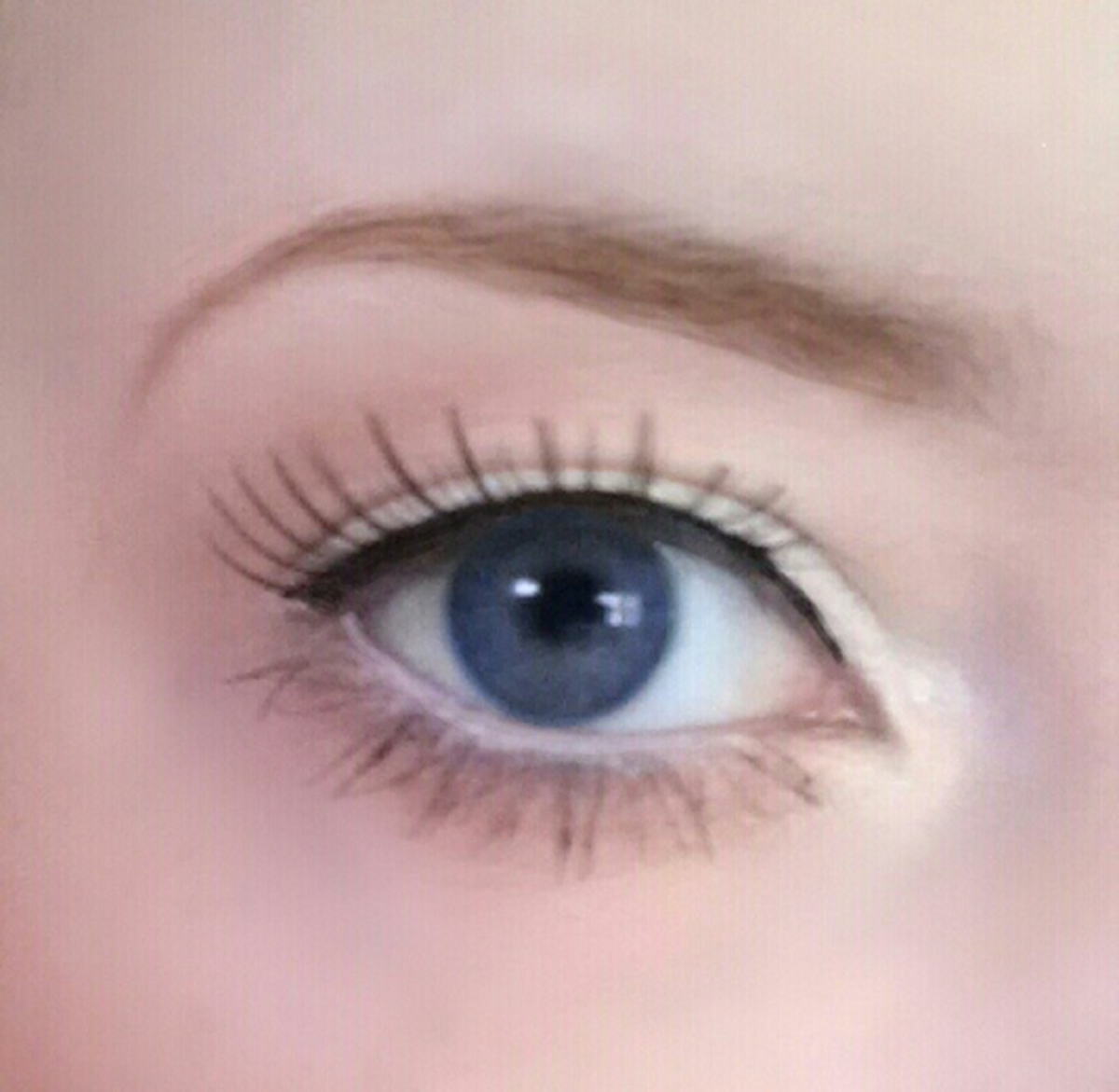 My hooded eye shown with a simple black liquid liner over top.