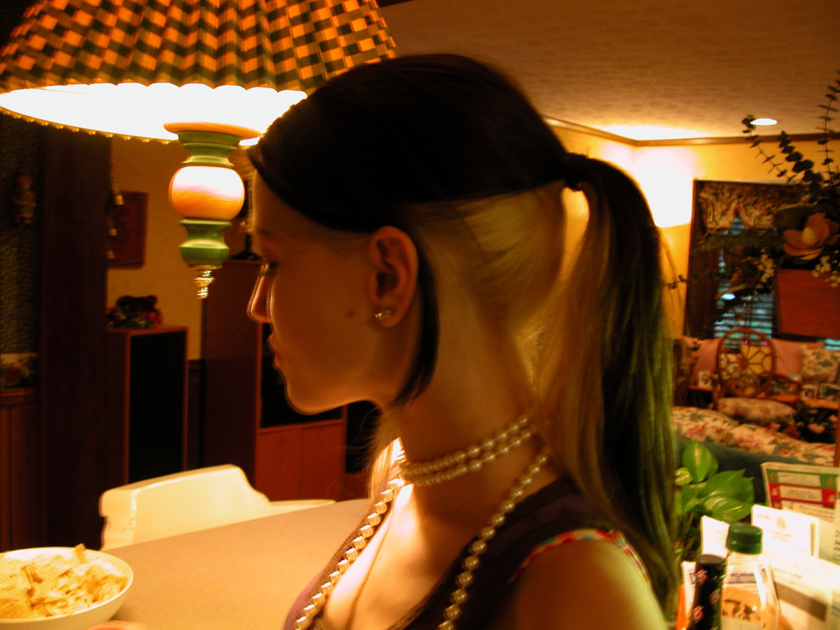 Black hair with blonde under-layers in a ponytail.