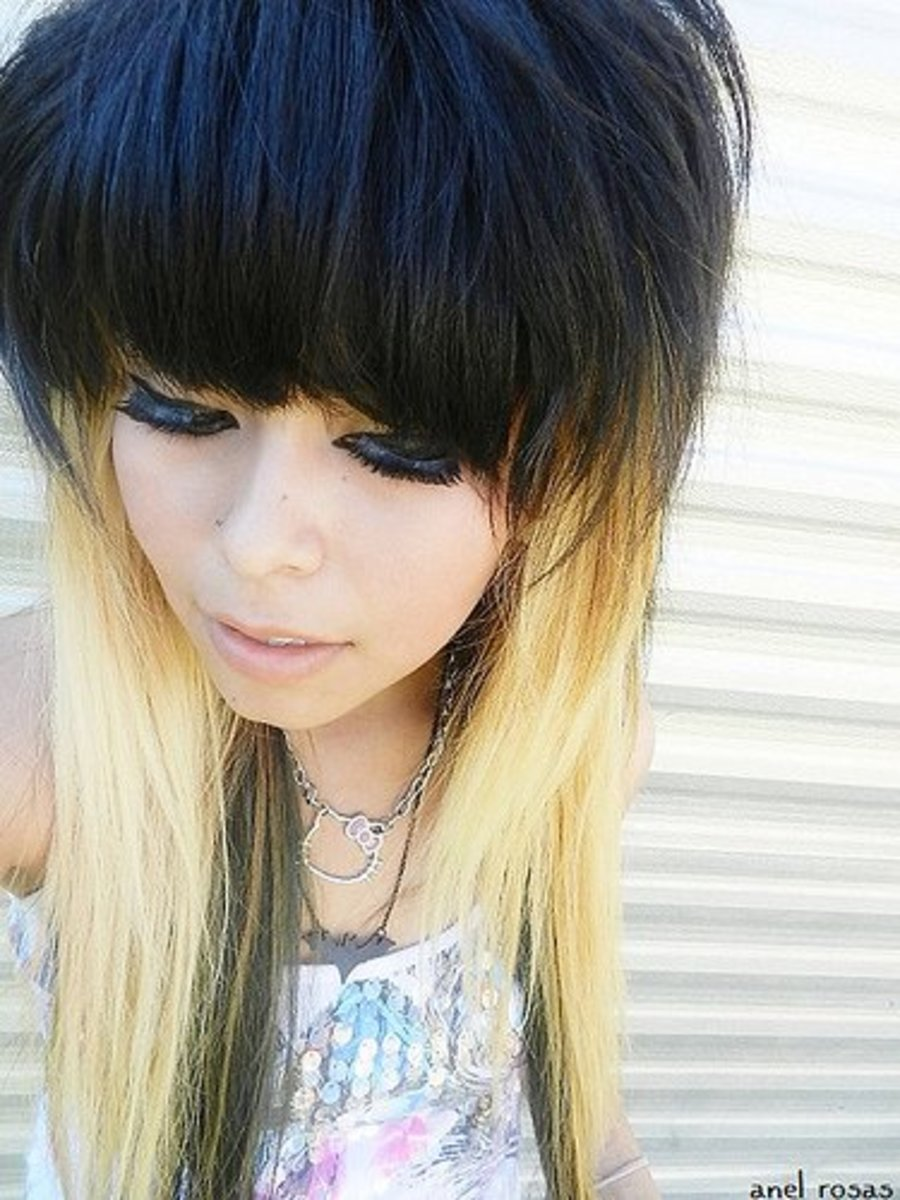 Black hair on top of the head with blonde on the bottom.