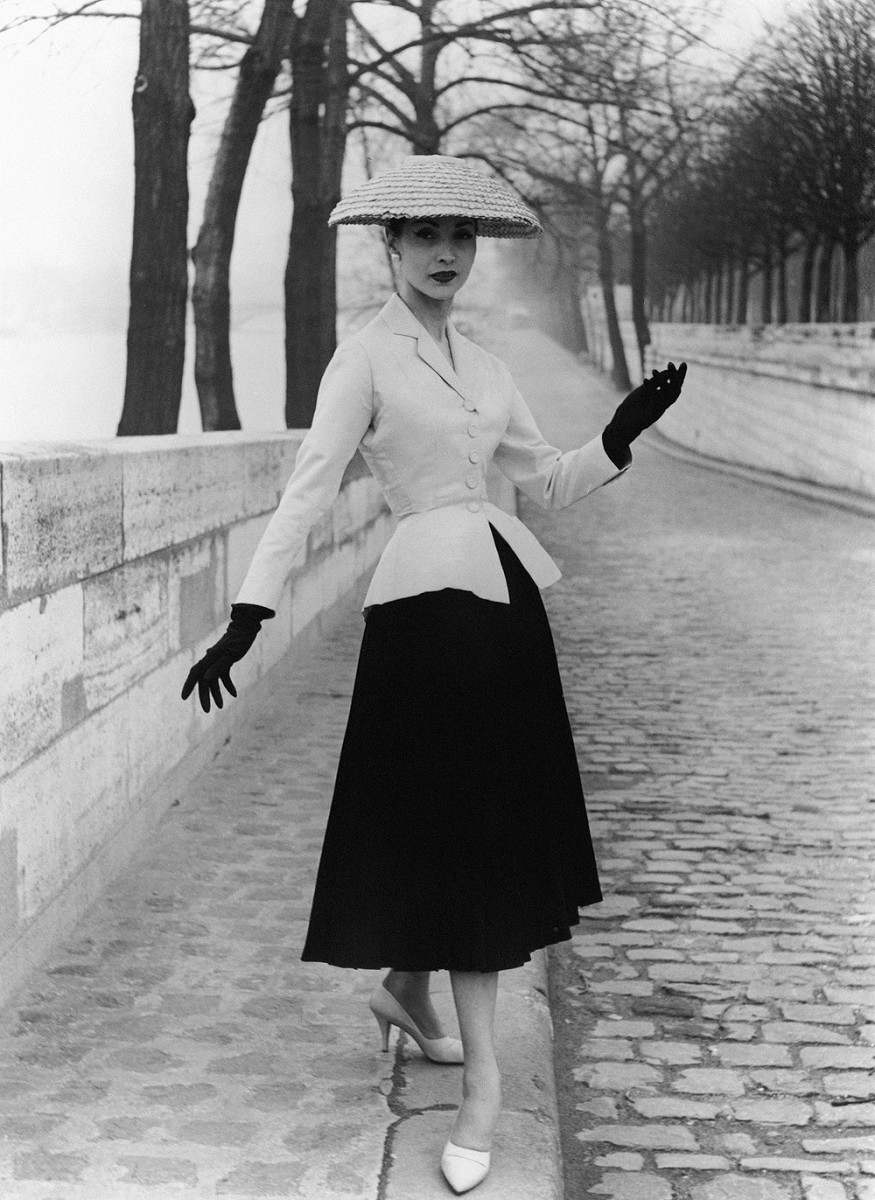 Photograph of 'New Look' suit designed by Christian Dior. Photographed by John French. London, England. 1947.