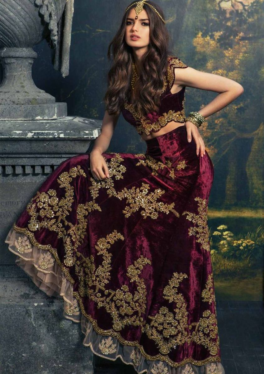 Flowing and voluminous maroon bridal lehenga.