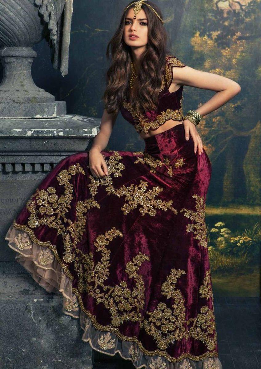 Flowing and voluminous maroon bridal lehenga.