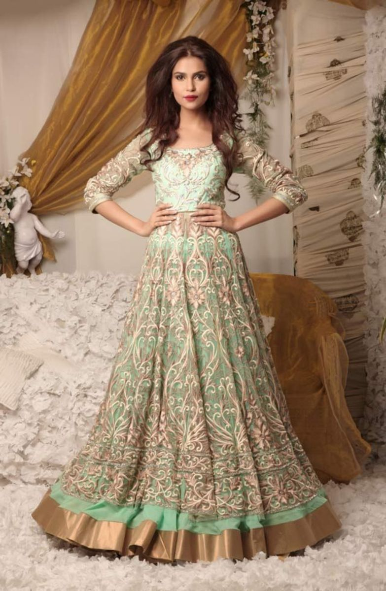 Pale green feminine, flowing and voluminous gown-type lehenga.