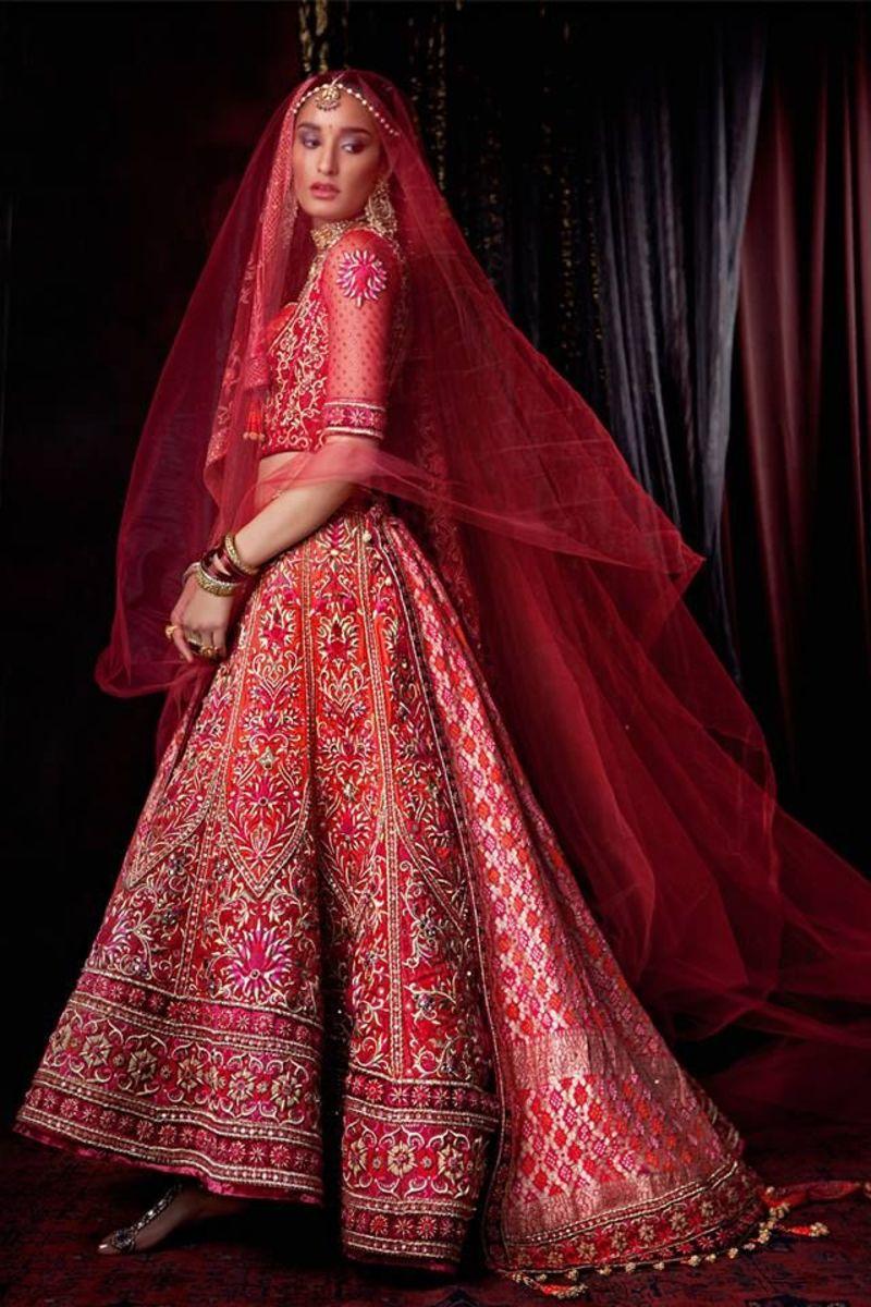 Gorgeous full-skirted all-red bridal lehenga.