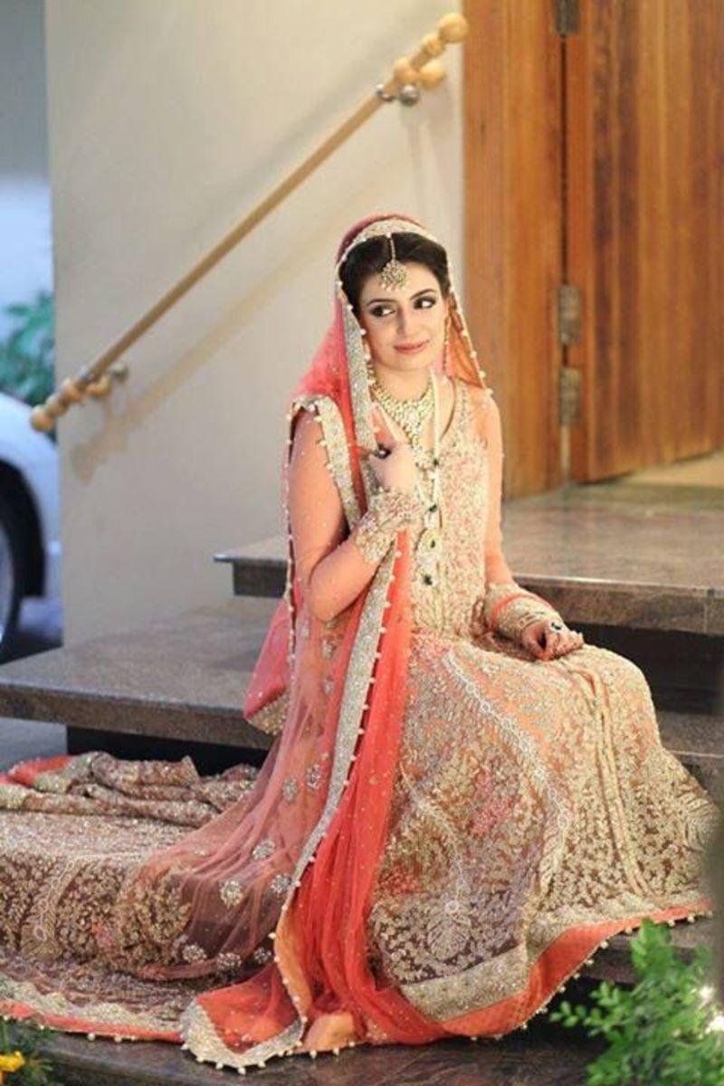 Pakistani bridal wear in peach tones.