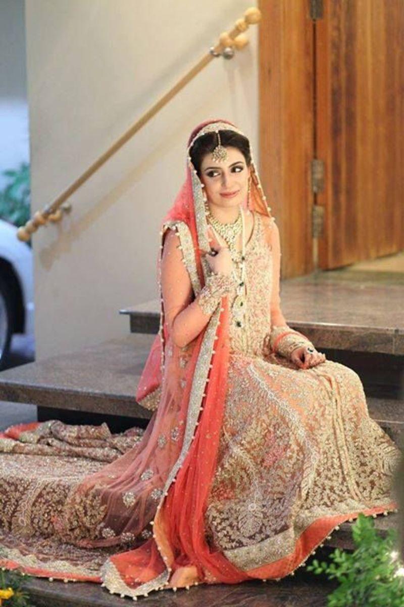 Pakistani bridal wear in peach tones.