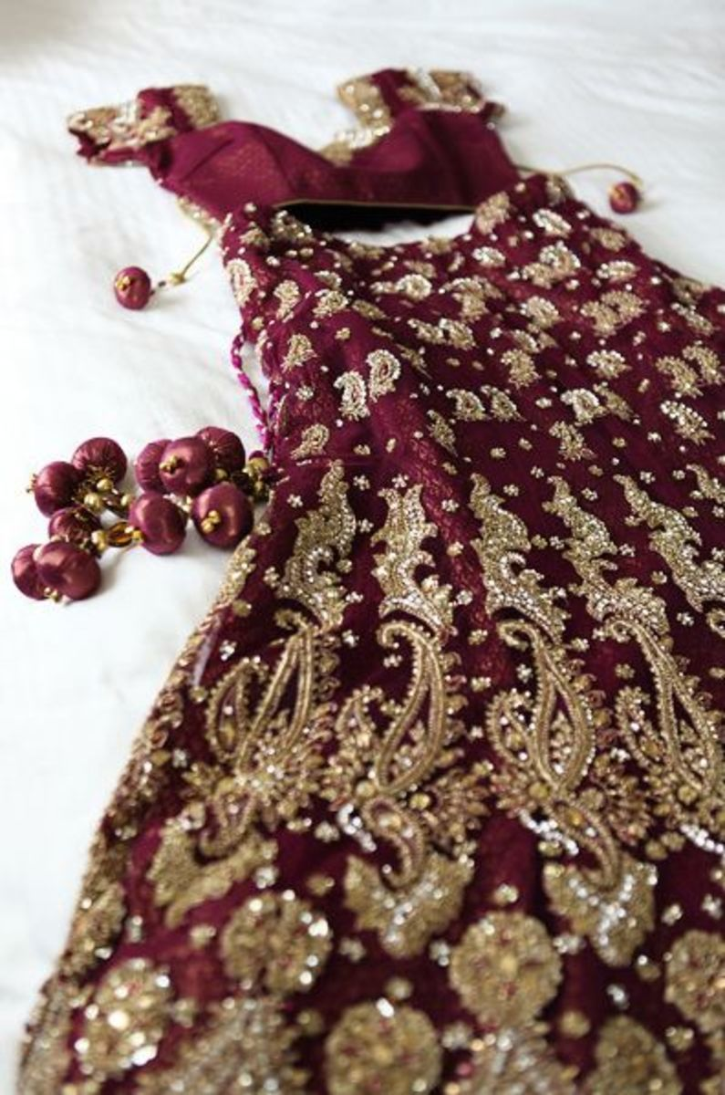 A-cut maroon wedding lehenga with heavy bronze zardozi work.