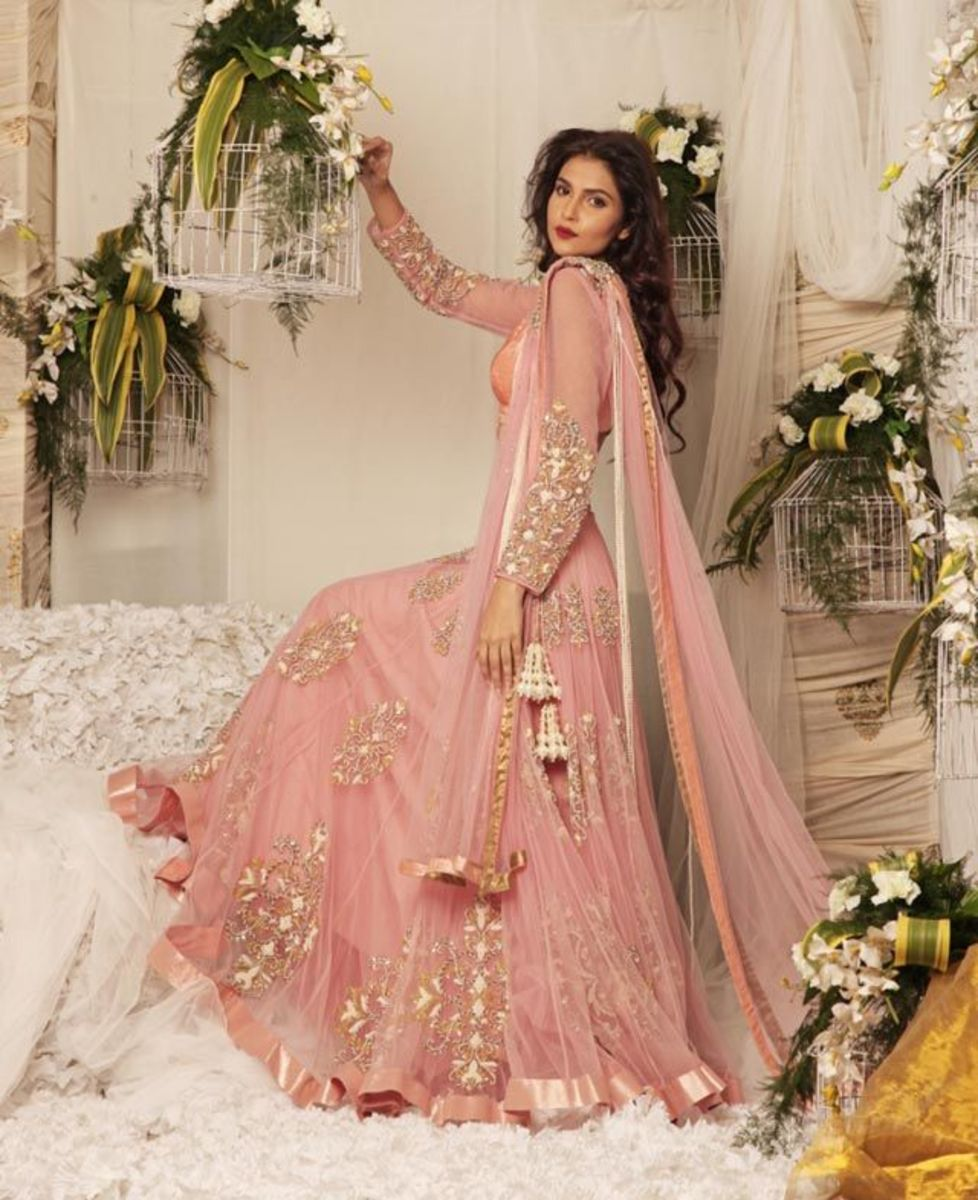 Glamorous peachy-pink bridal dress.