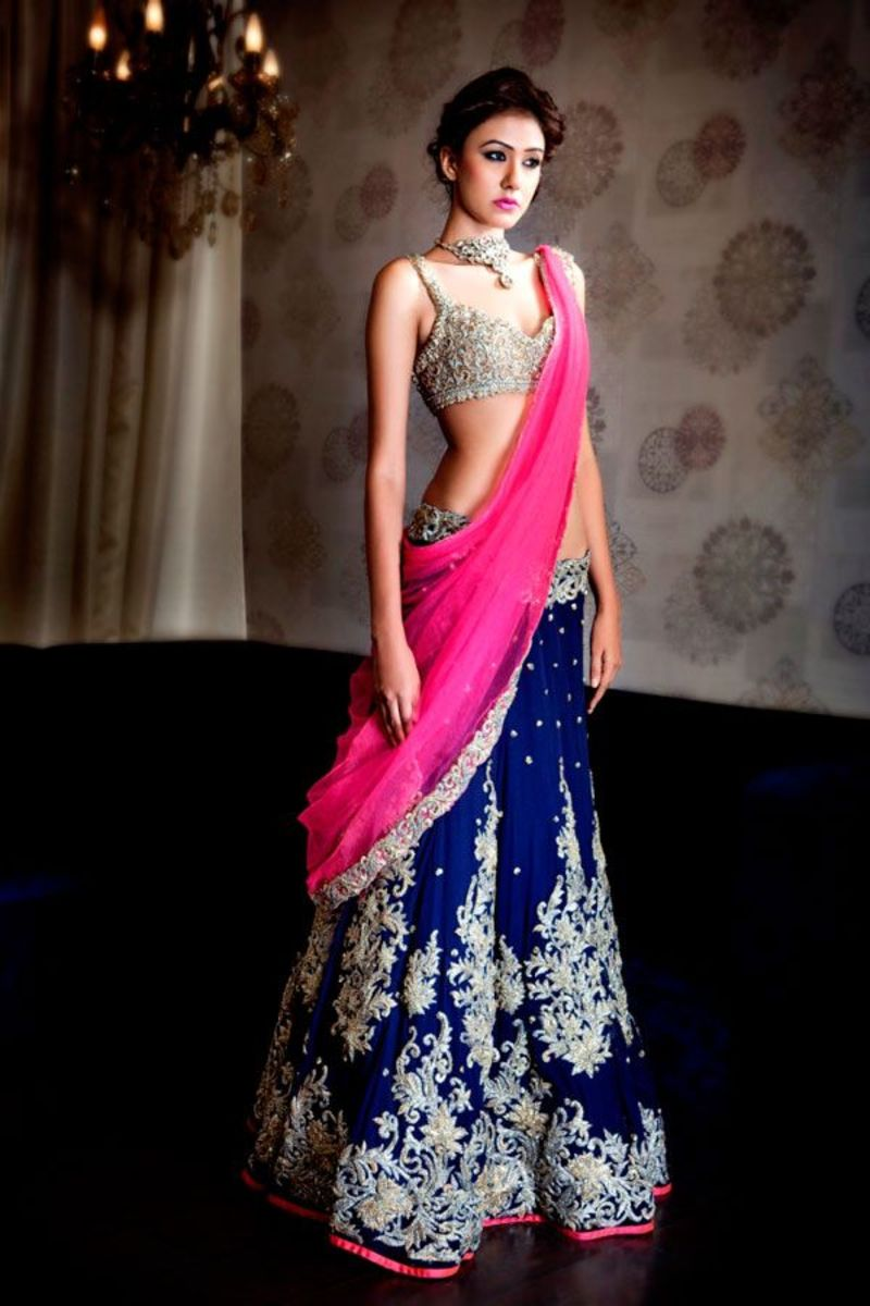 Beautiful deep royal blue velvet lehenga skirt with fuchsia dupatta and accents.