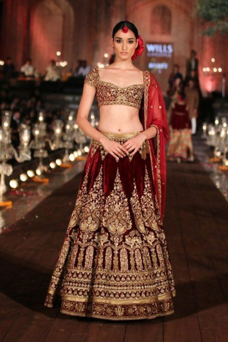 Deep maroon designer lehenga wedding skirt.