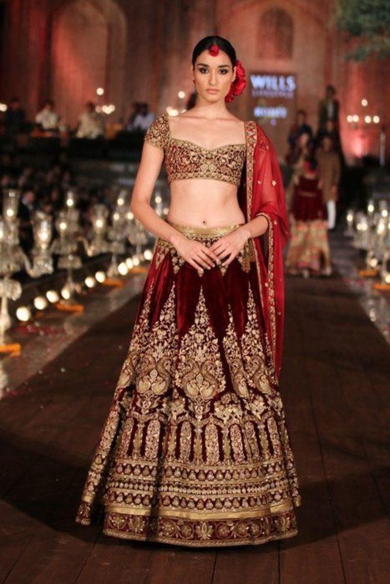 Deep maroon designer lehenga wedding skirt.