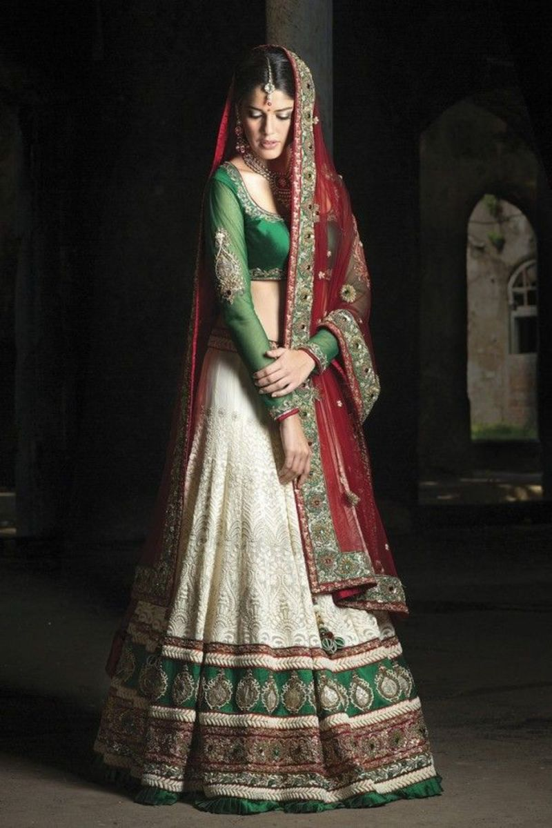 This is an A-cut lehenga skirt in off-white, green and red.