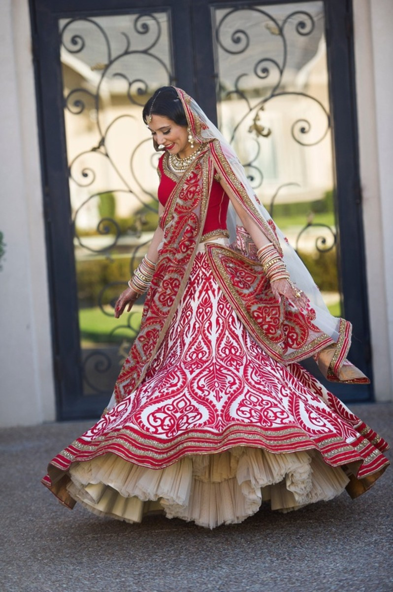 Feminine, flowing and voluminous lehenga with hemline frills.