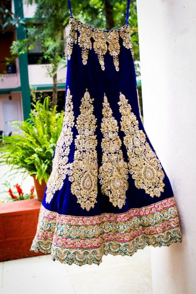 A-cut navy blue wedding lehenga with heavy zardozi work.