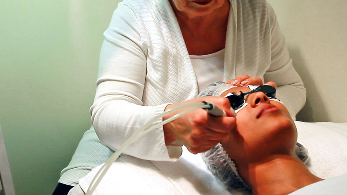 Technician administering skin treatment