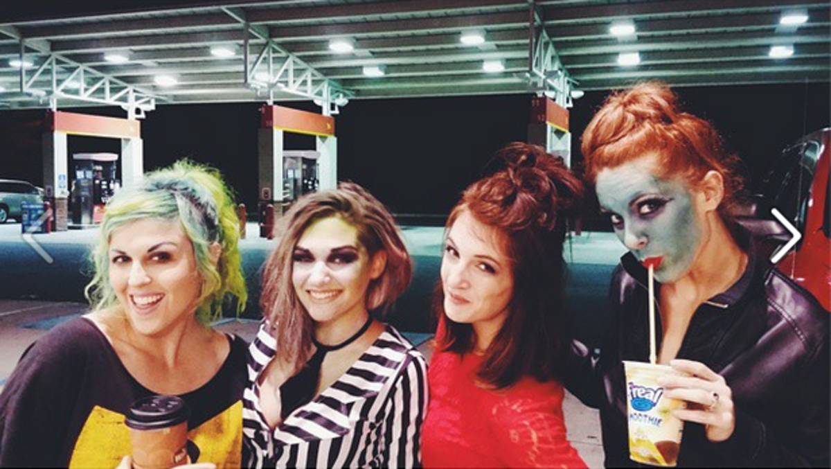 And for reference, here is my hair now (I'm in red) approximately three months and some change later. Don't mind us, just being Lydia from Beetlejuice in the Wawa parking lot.