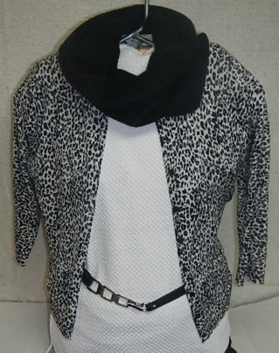 White top $5 off-season sale, leopard print sweater $3.57 at a thrift store, belt $1.25 overstock sale, funnel scarf $2.50 clearance sale. Outfit total? $12.32!