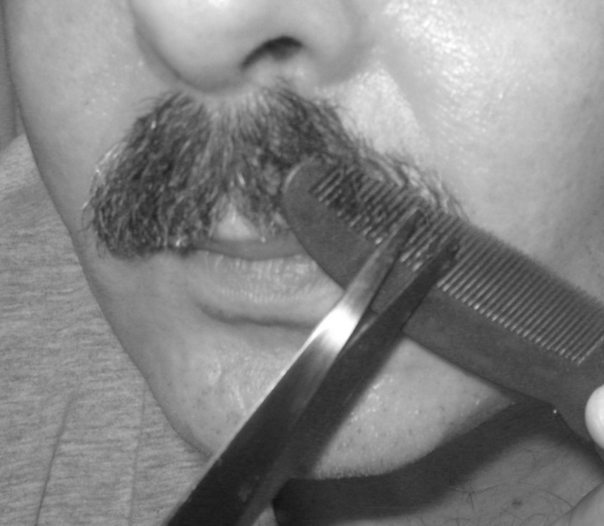Thinning a mustache: Hold the comb upside down and push it under the mustache.