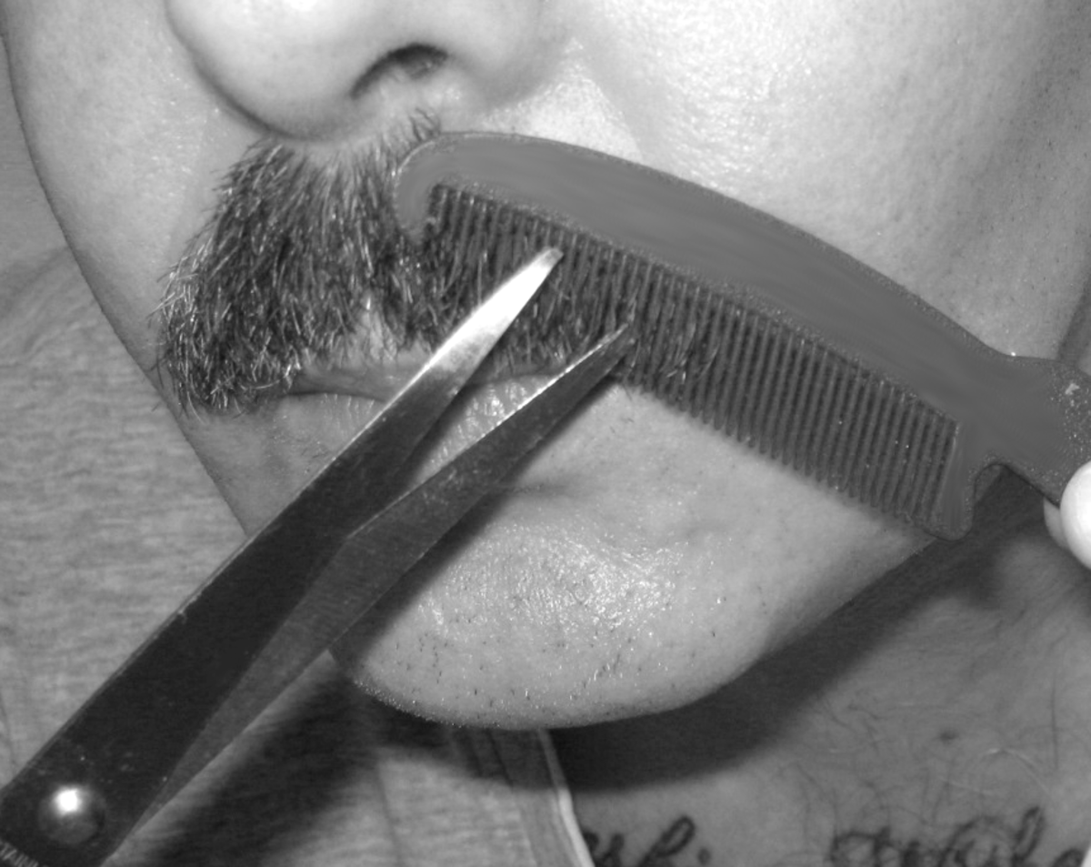 Tidying a mustache: Run the comb lightly over one half of the mustache. Hairs that don't lie flat will poke through its teeth.