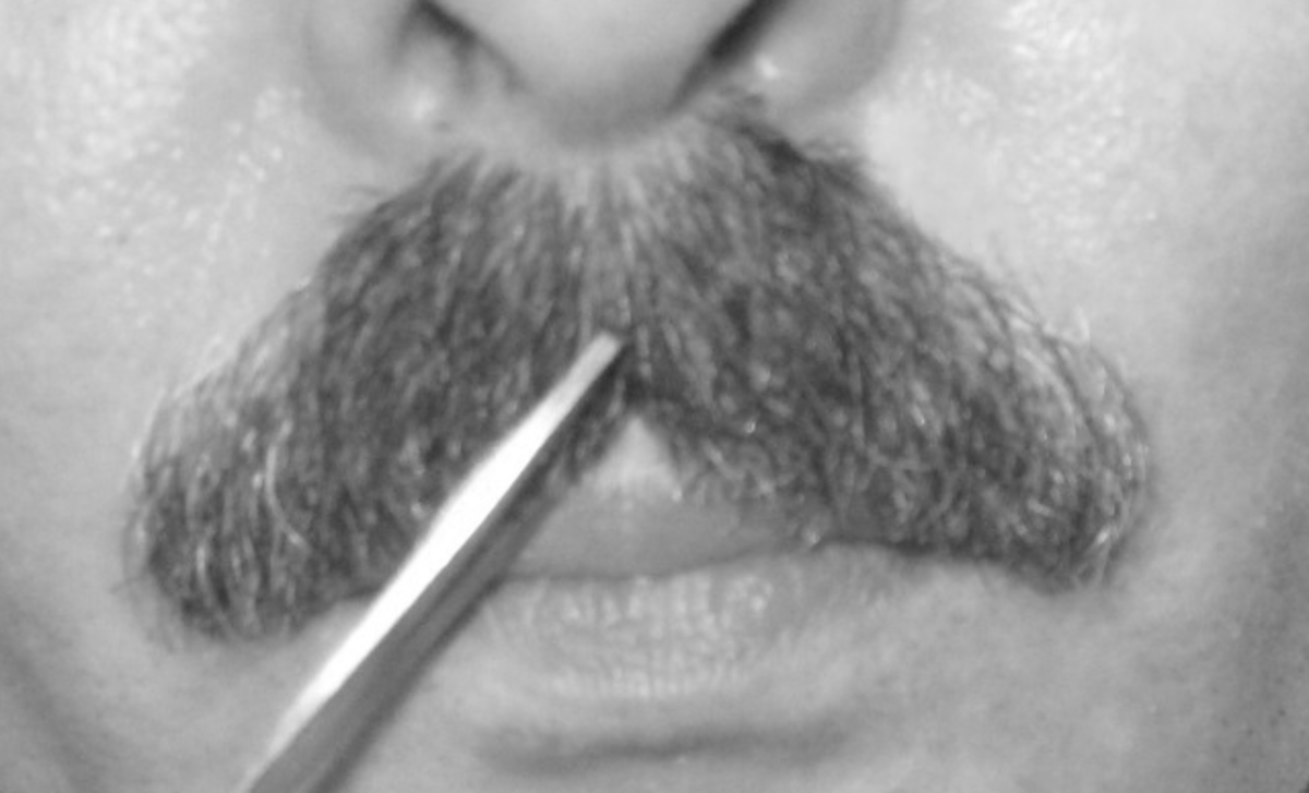 The philtrum: Cut a nick into the center of the mustache at the bow of the lip.