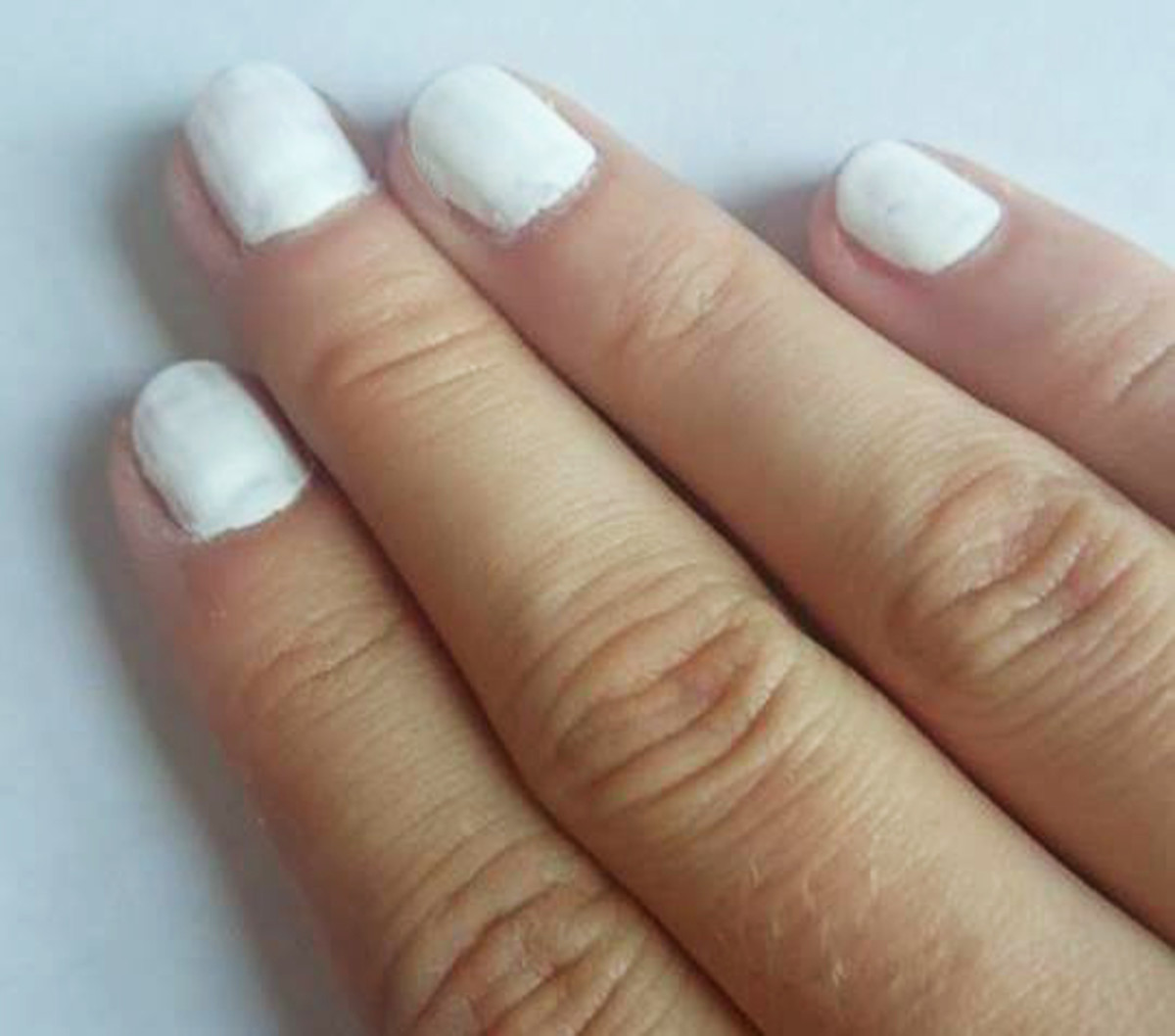 Paint the nails white using one or two coats of polish.