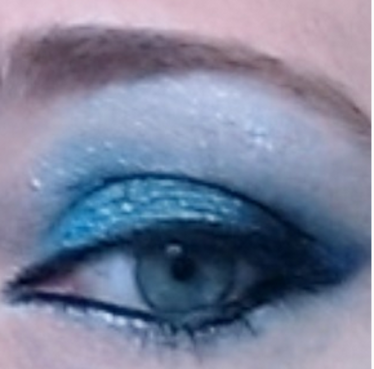 Maybelline's Tenacious Teal with Too Cool brow bone and under-eye  highlights