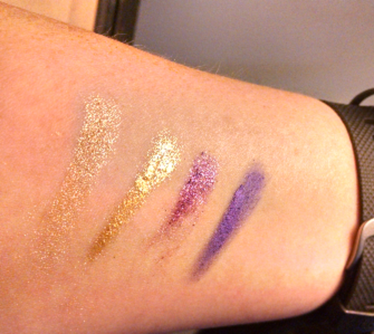 From left to right: L'Oreal's Amber Rush, Maybelline's Bold Gold, L'Oreal's Burst into Bloom, & Maybelline's Painted Purple