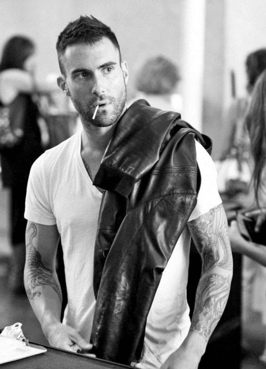 Here, Maroon 5's Adam Levine pairs a plain white tee with a dark leather jacket. In this case, his stubble really helps complete the look.