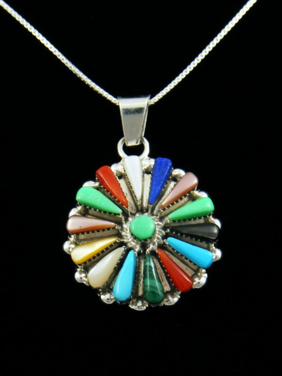 Zuni inlay pendant with many different colorful stones.