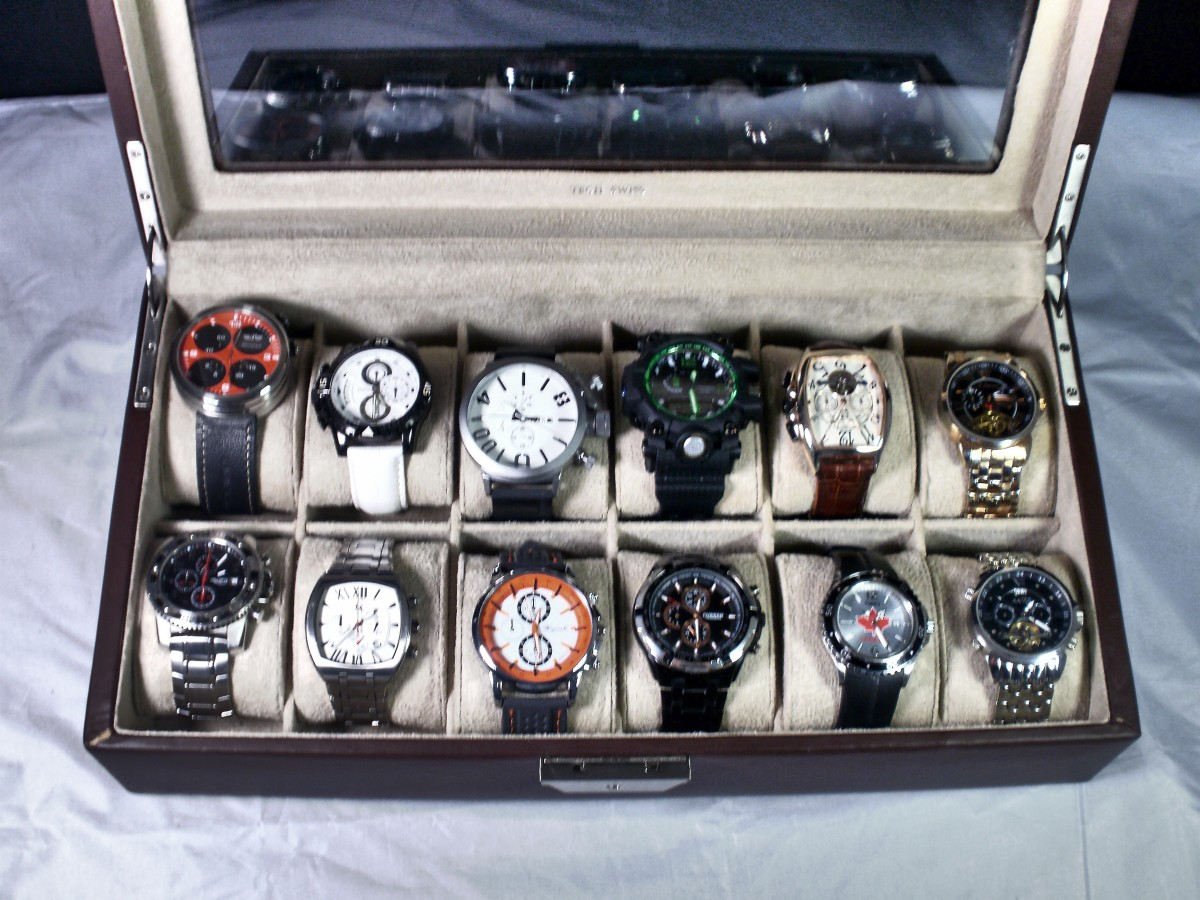 All of these large watches fit nicely into the display case  without intruding into adjoining grids.