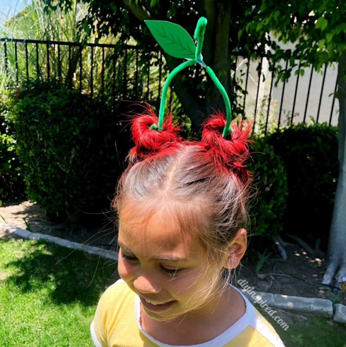 Anyone can do this crazy hair day style, but you need long hair.