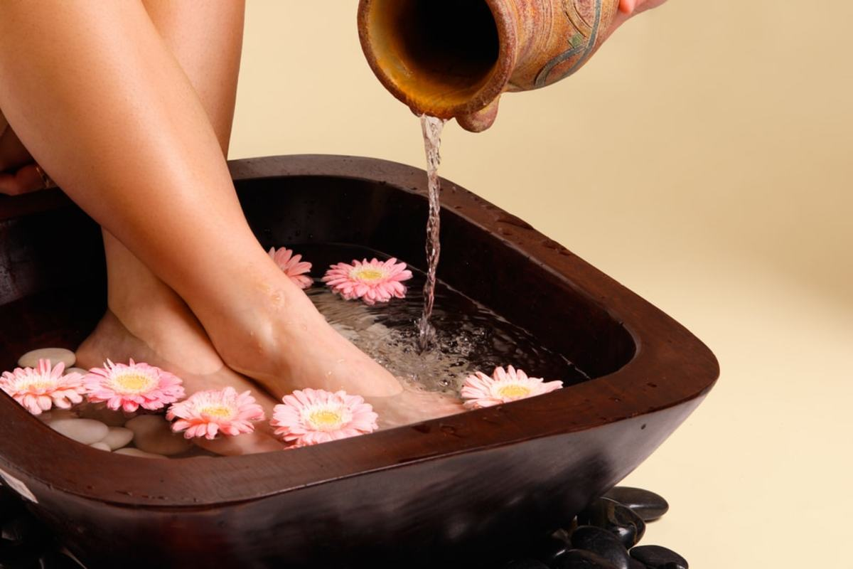 You don't have to have a fancy bowl and flowers like this to soak your feet, a bathtub works just as well.